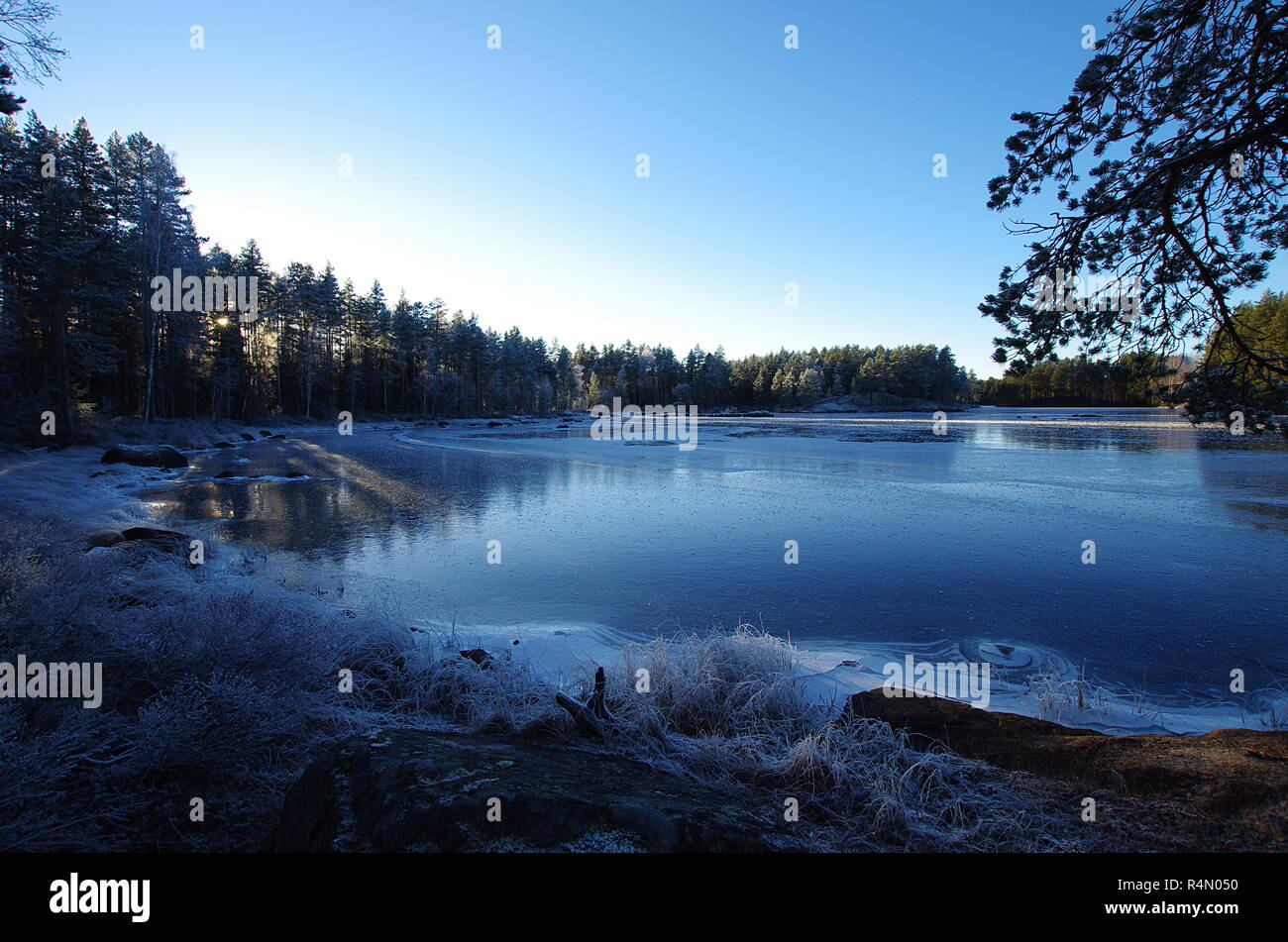 A frozen lake in Dalarna on a cold winter day - Stock Image
