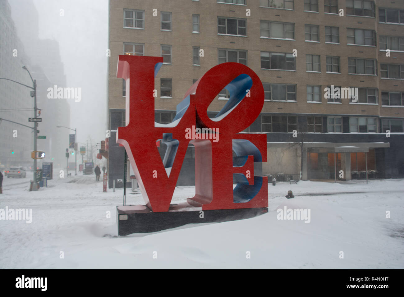 LOVE statue on New York City street in the blizzard of 23rd January 2016 with heavy snowfall and no traffic - Stock Image