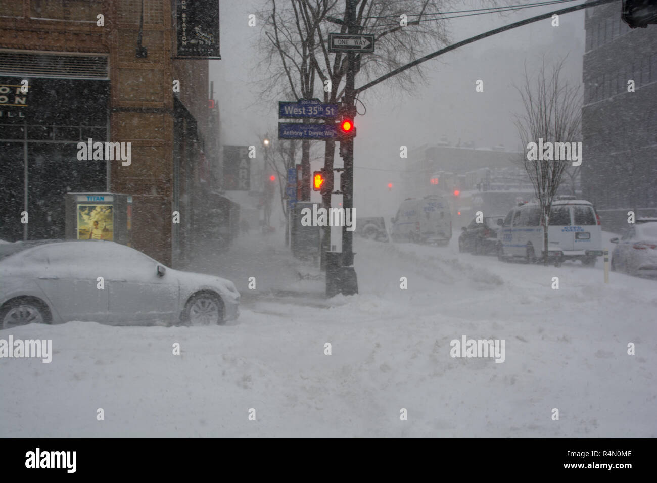 New York City streets in the blizzard of 23rd January 2016 with heavy snowfall and no traffic and snow covered car - Stock Image