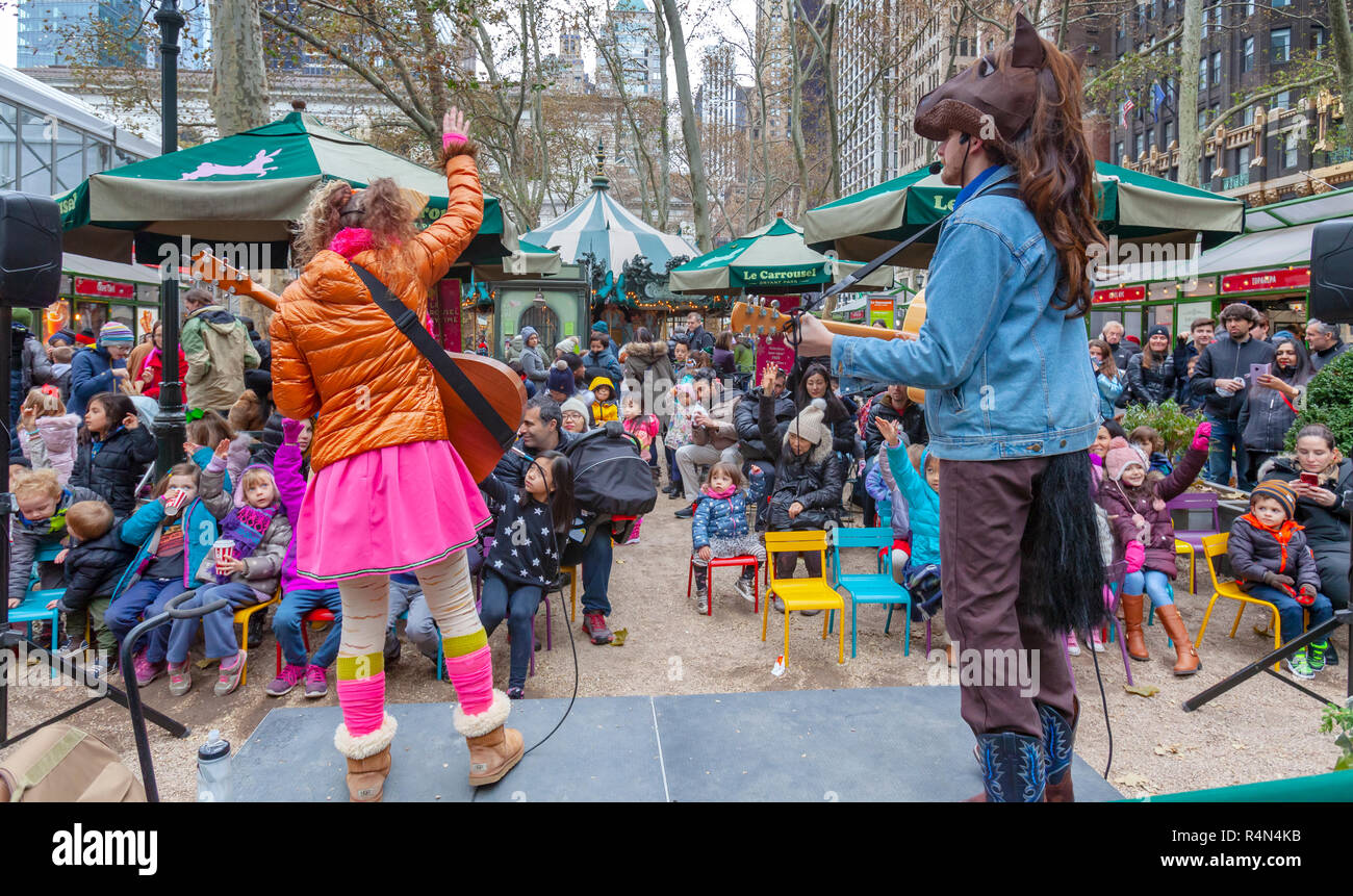 Performers on Stage performing for children in the Winter Village at Bryant Park, Manhattan, New York City. - Stock Image