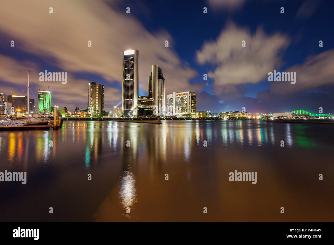 Harbor and cityscape of Corpus Christi at night in Texas - Stock Image