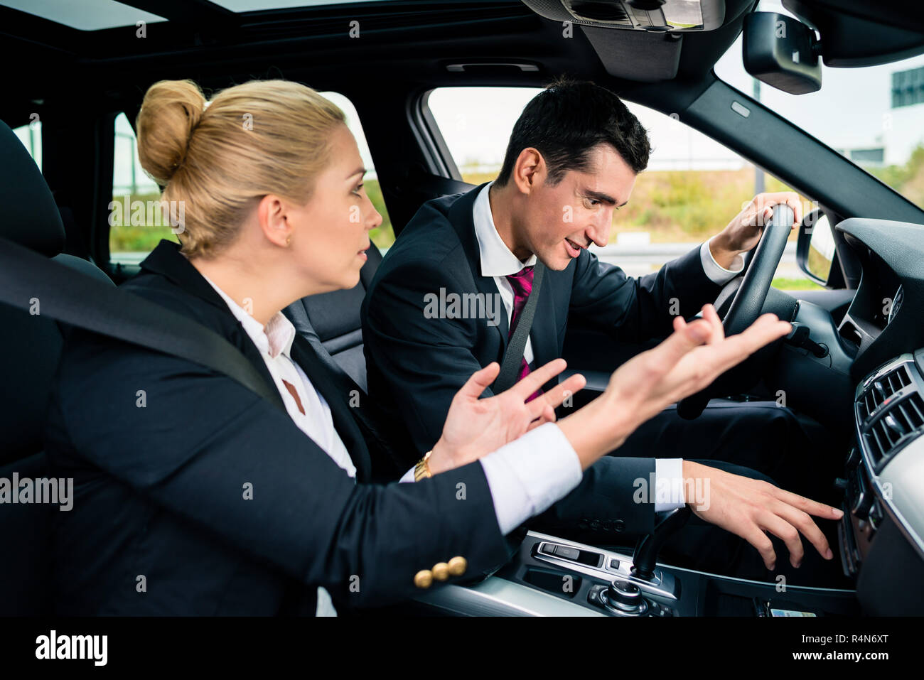 Man being lost in car, woman yelling at him - Stock Image