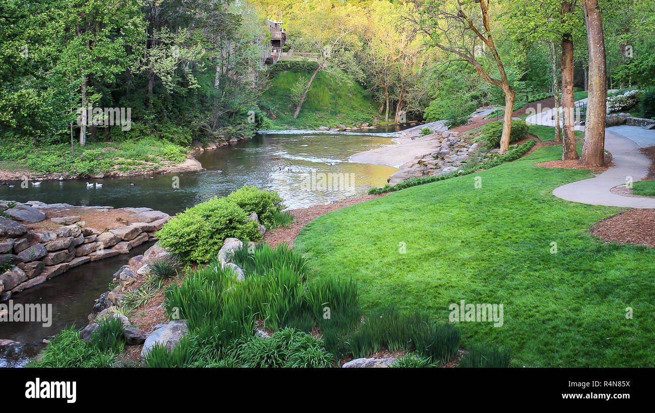 Iconic Greenville South Carolina Falls downtown park on the Reedy during sunset - Stock Image
