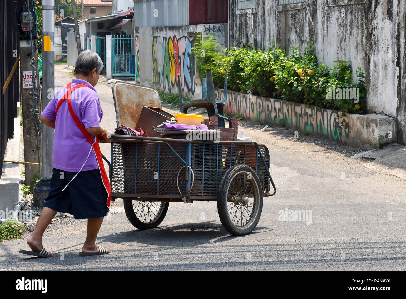 Woman collecting scrap materials Chiang Mai, Thailand - Stock Image
