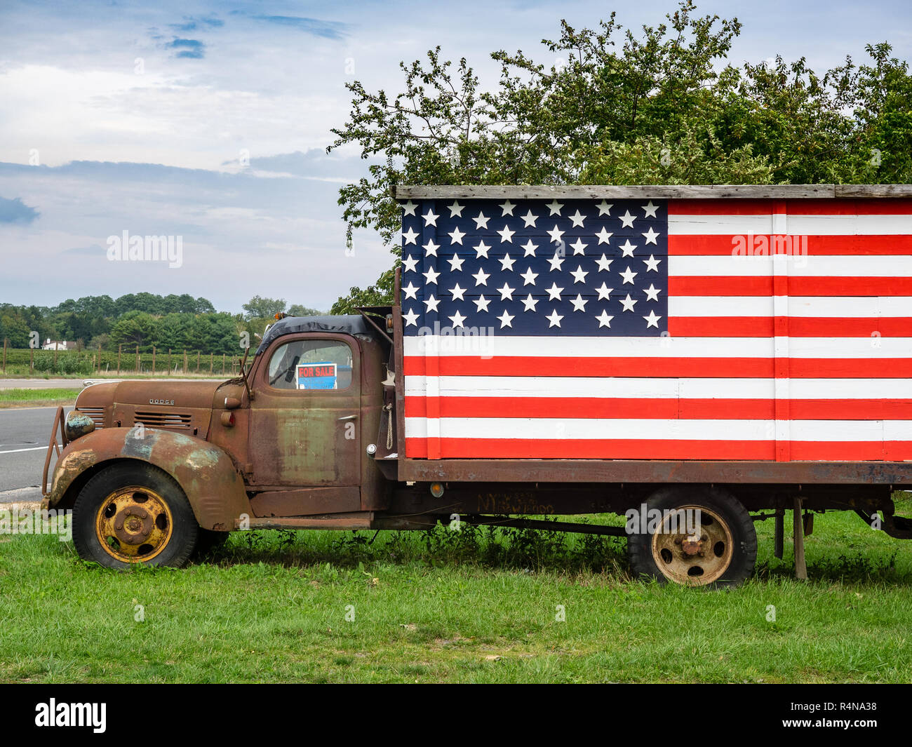 Rusted Pick Up Truck With American Flag North Fork New York Stock Photo Alamy