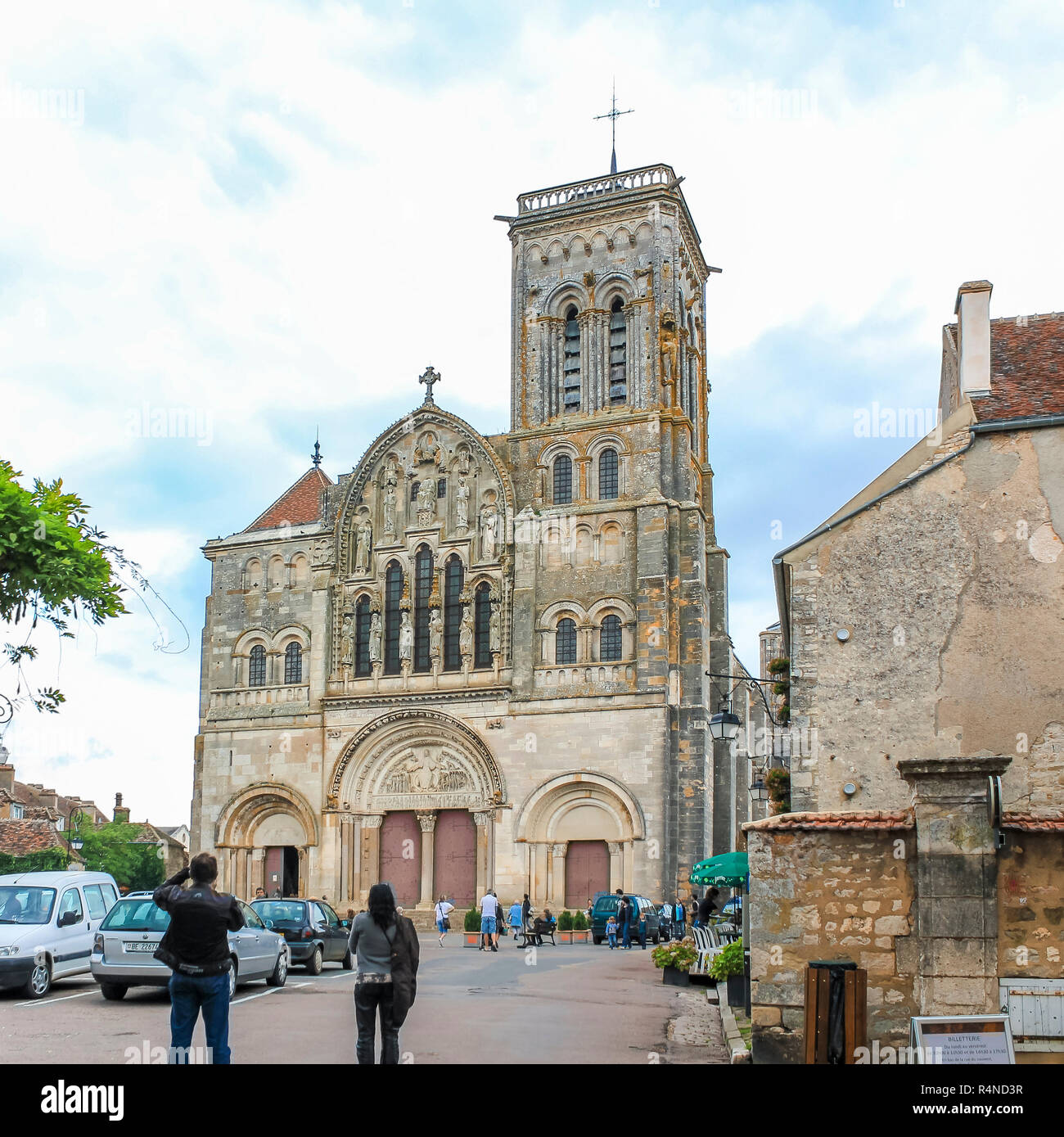VEZELAY, FRANCE - JULY 28, 2011: Village scene, with the Benedictine abbey church and visitors. - Stock Image