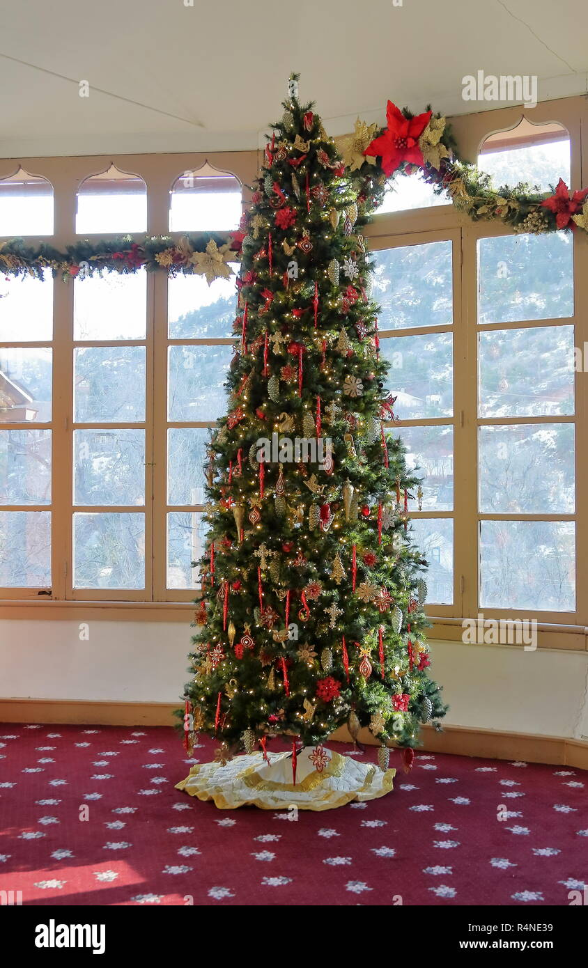 Christmas Tree And Windows Decorations In Traditional Home