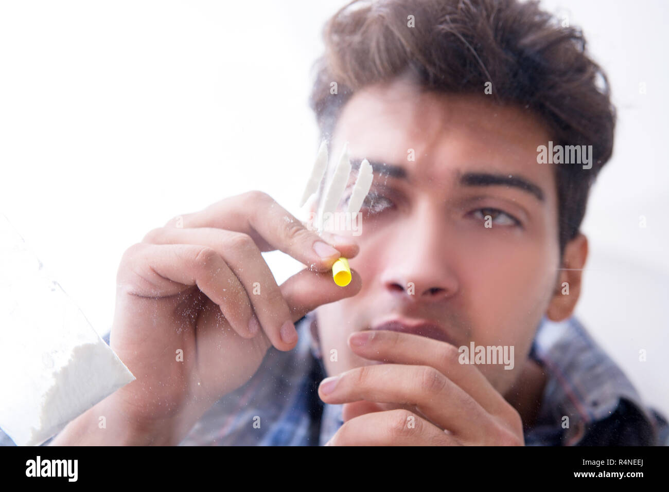 Drug addict sniffing cocaine narcotic Stock Photo: 226665786