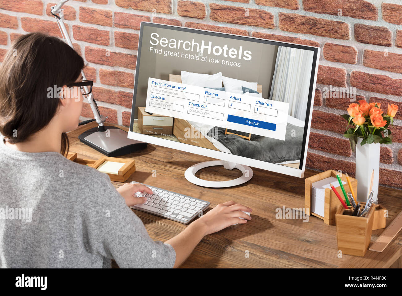 Woman Searching Hotels Online - Stock Image