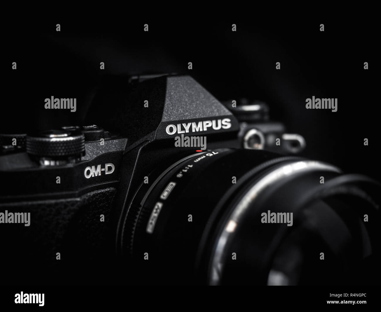 Close up of a black Olympus  OM-D EM-5 Mark II camera on a dark background - Stock Image