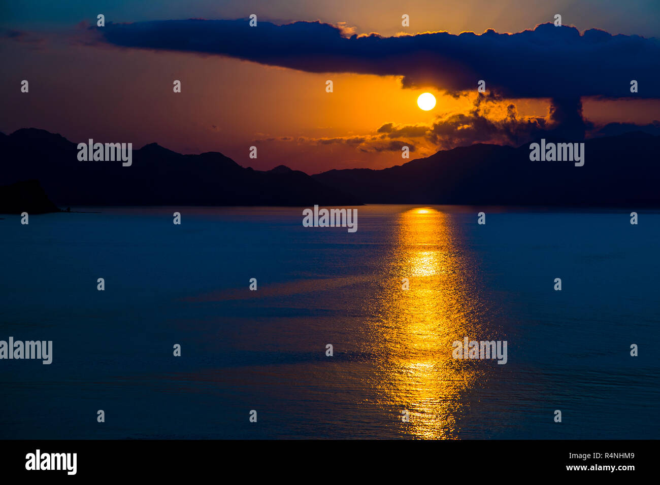 Sunset from the same viewpoint on Komodo Island, Indonesia (sequence of images) - Stock Image