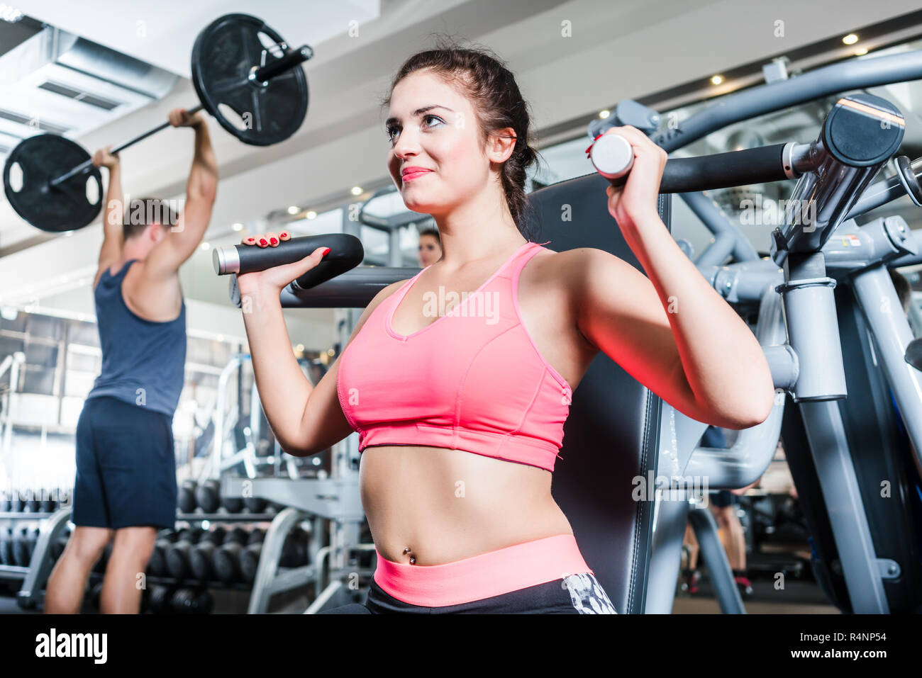 Woman and man having sport training in fitness gym - Stock Image