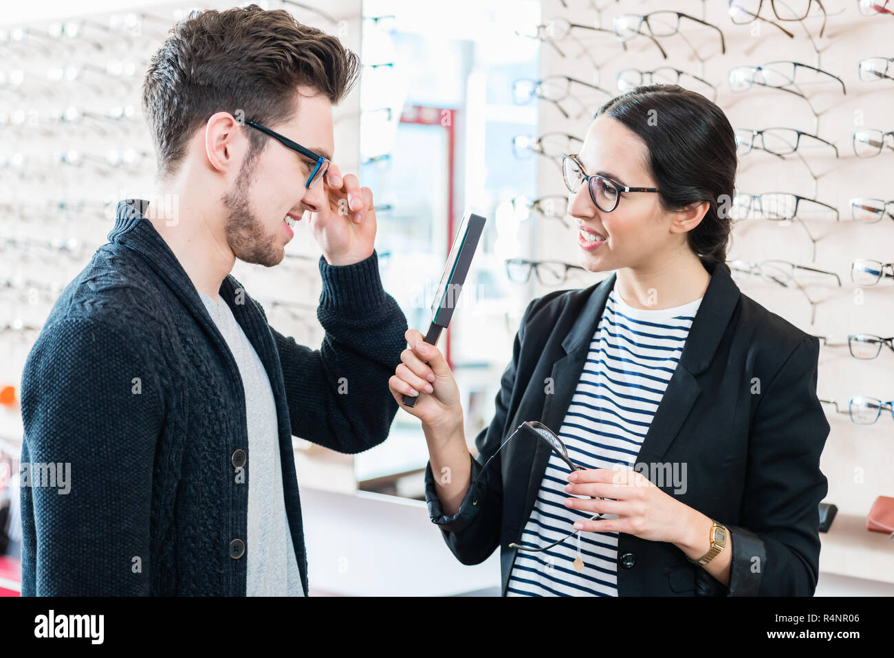15de2db9ba Woman and man buying glasses in optician shop Stock Photo  226672438 ...