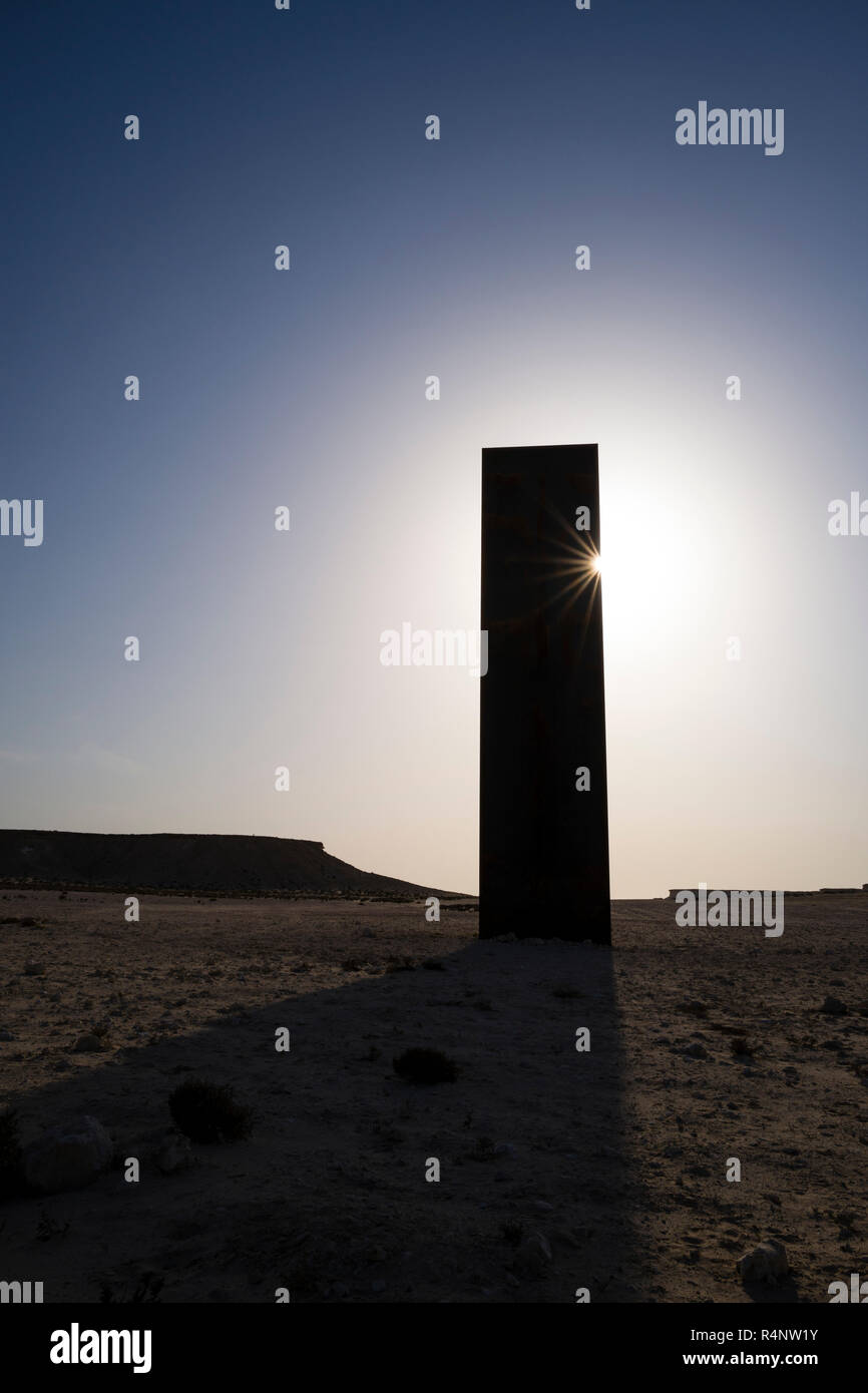 An art installation called East-West / West-East by American artist Richard Serra. The installation compromises of 4 huge steel plates each more than 14 meters high protruding from the ground at a location named Zekreet, a popular place just 1.5 hours away from Doha in the Qatari desert.†Stock Photo