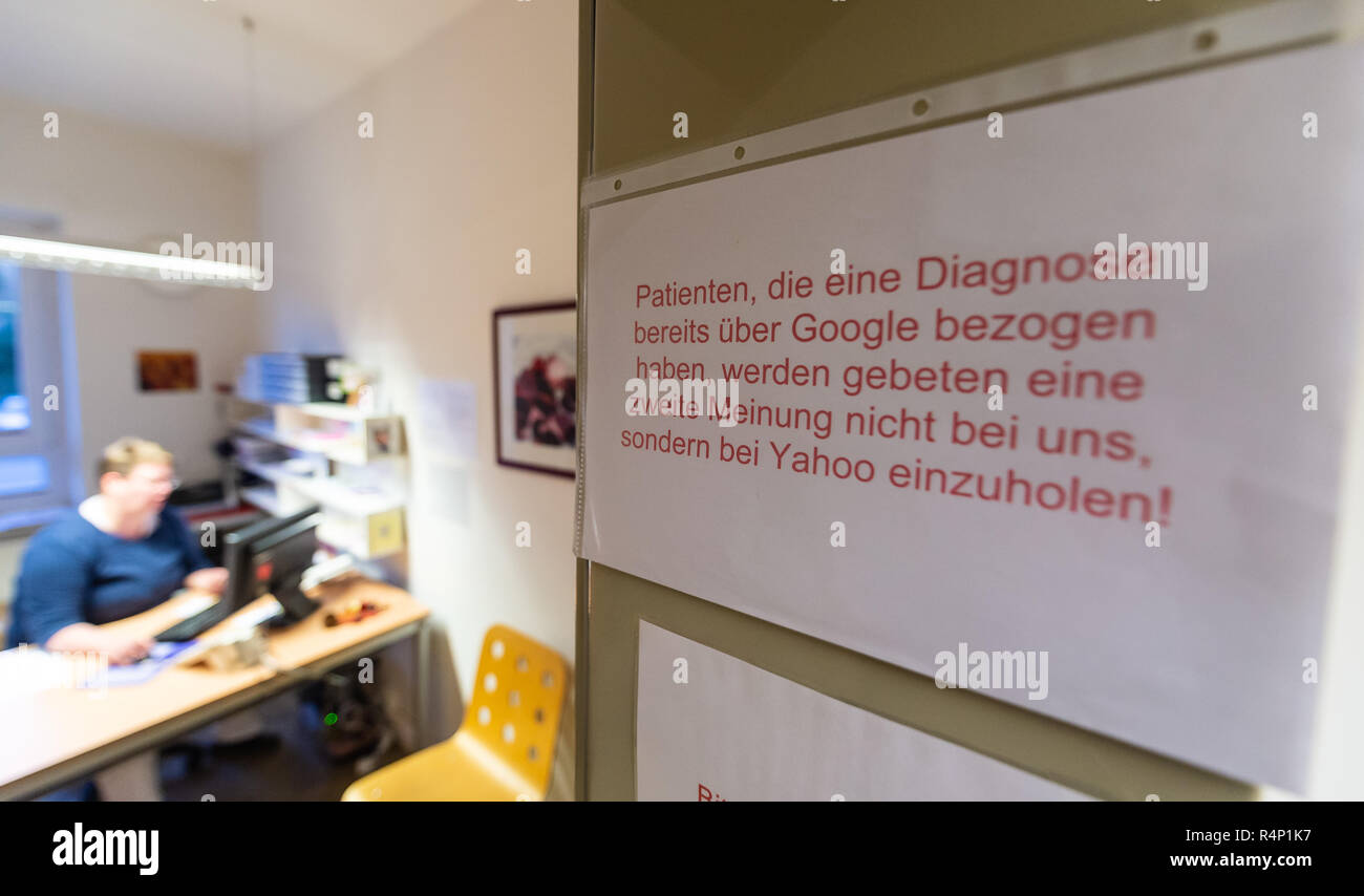 27 November 2018, Lower Saxony, Lüneburg: ILLUSTRATION - A piece of paper that can be understood with a twinkle in the eye hangs in the registration area of a GP's practice. The Digital Summit on Health, which will be held on Wednesday by the Medical Association of Lower Saxony and the Hanover University of Applied Sciences and Arts, will focus on the future of telemedical treatment models, among other things. Photo: Philipp Schulze/dpa - Stock Image