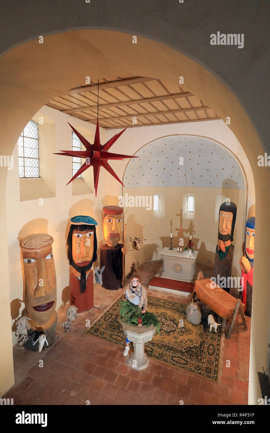 21 November 2018, Saxony-Anhalt, Zerbst: In the Polenzko Christmas Church there are over three metre high crib figures of Mary, Joseph, the Christ Child and shepherds. For centuries, nativity scenes depicting the birth of Christ have been part of Christmas. A very special example can be found in the Christmas Church in the Zerbst district of Polenzko. Photo: Peter Gercke/dpa-Zentralbild/ZB Stock Photo