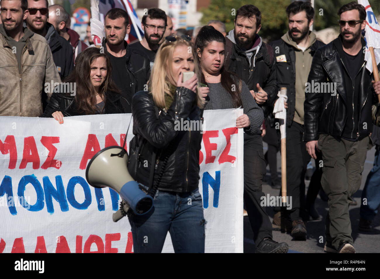 Athens, Greece. 28th Nov 2018. Strikers march holding banners and shouting slogans against labor legislation. Thousands took to the streets participating in a 24 hour general strike organized by private sector unions, protesting against unemployment, low wages and the current labor legislation. Credit: Nikolas Georgiou/Alamy Live News - Stock Image