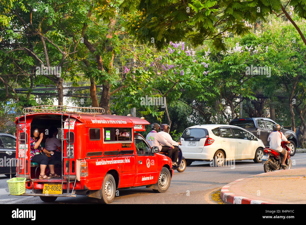 Typical red songthaew taxi, Chiang Mai - Stock Image