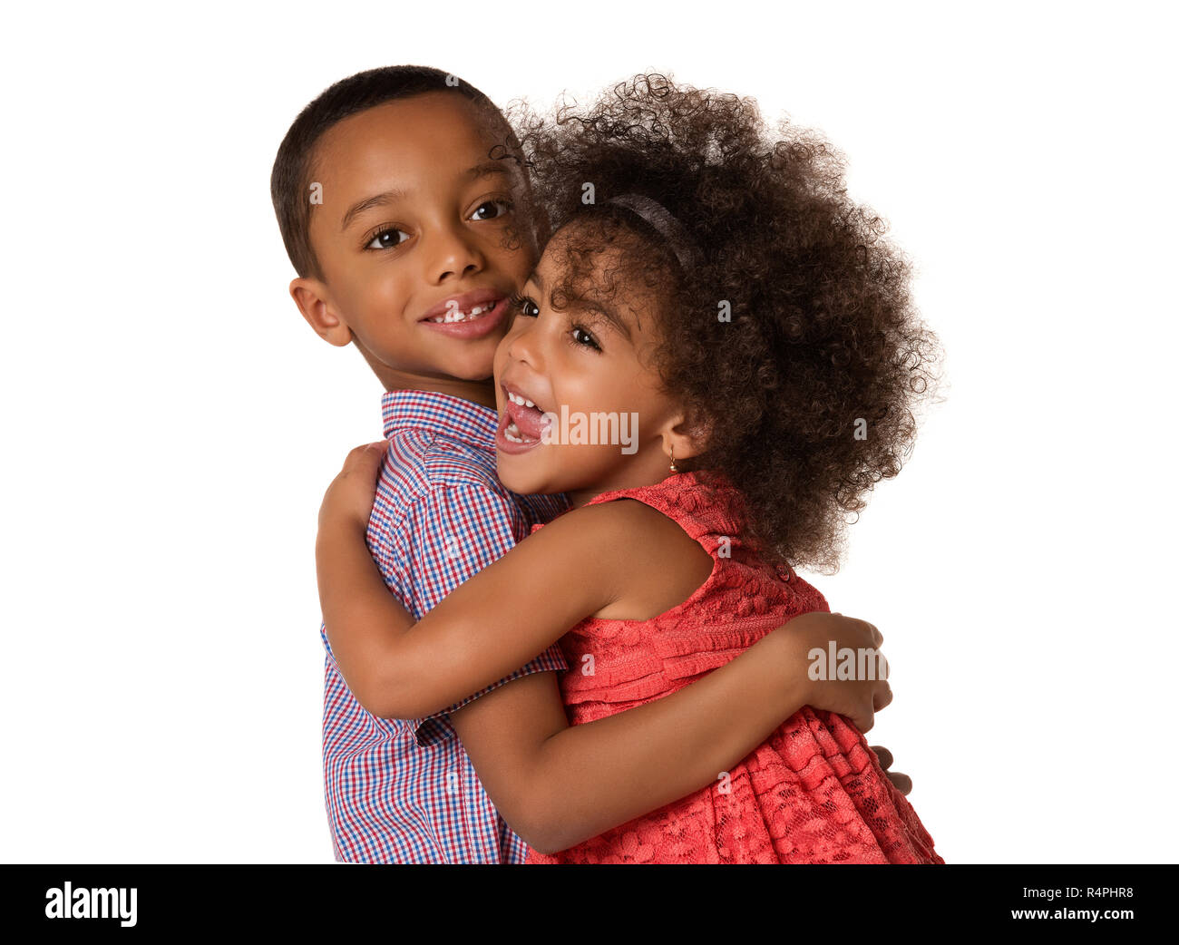 Two cheerful african-american siblings brother and sister hugging each other, isolated on white background Stock Photo