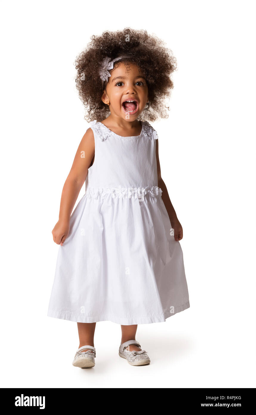 Full-length portrait of cute cheerful african american little girl, isolated over white background - Stock Image