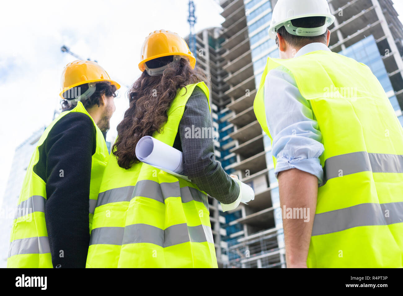 Construction engineers at building site of high-riser - Stock Image