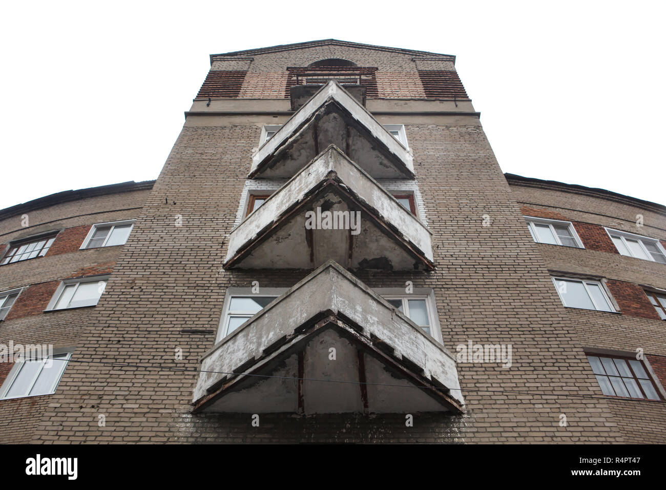 Triangular balconies of the constructivist dwelling complex nicknamed the Horseshoe House in Ivanovo, Russia. The apartment building designed by Soviet modernist architect Alexander Panov was built in 1933-1934 in Gromoboya Street as a dwelling complex for the staff of the OGPU, secret police of the Soviet Union from 1923 to 1934, later known as the NKVD and the KGB. ATTENTION: This image is a part of a photo essay of 35 photos featuring Soviet constructivist architecture in Ivanovo. - Stock Image