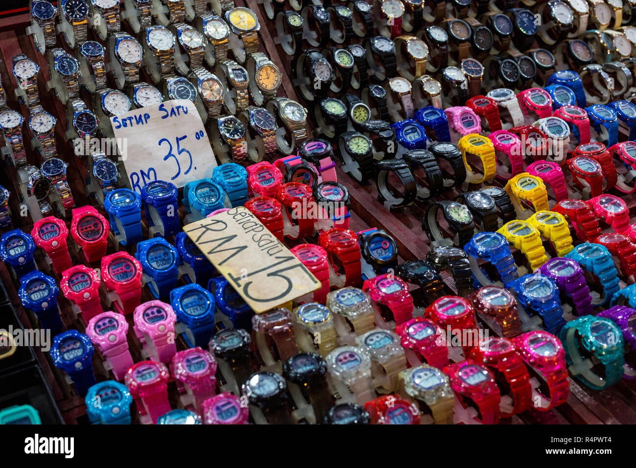 Watches for Sale at Nighttime Flea Market, Ipoh, Malaysia. - Stock Image