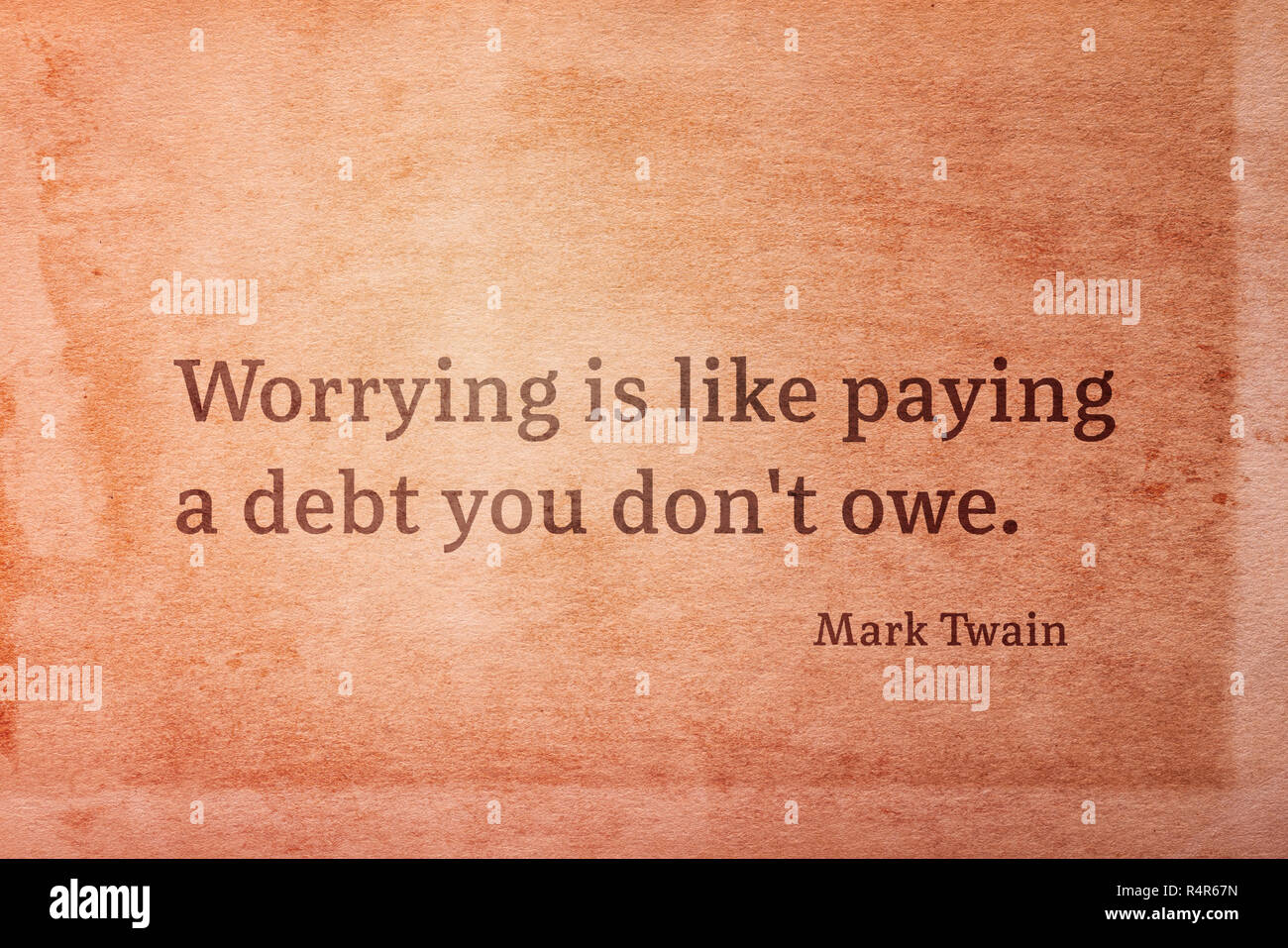 Worrying is like paying a debt you don't owe - famous American writer Mark Twain quote printed on vintage grunge paper - Stock Image