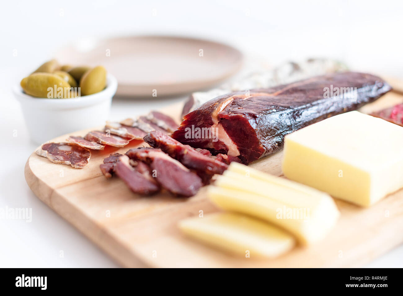 Sliced meat, cheese and chocolate. Selective focus. Food for Christmas selebration. Happy winter holidays. Presents for Christmastime Stock Photo