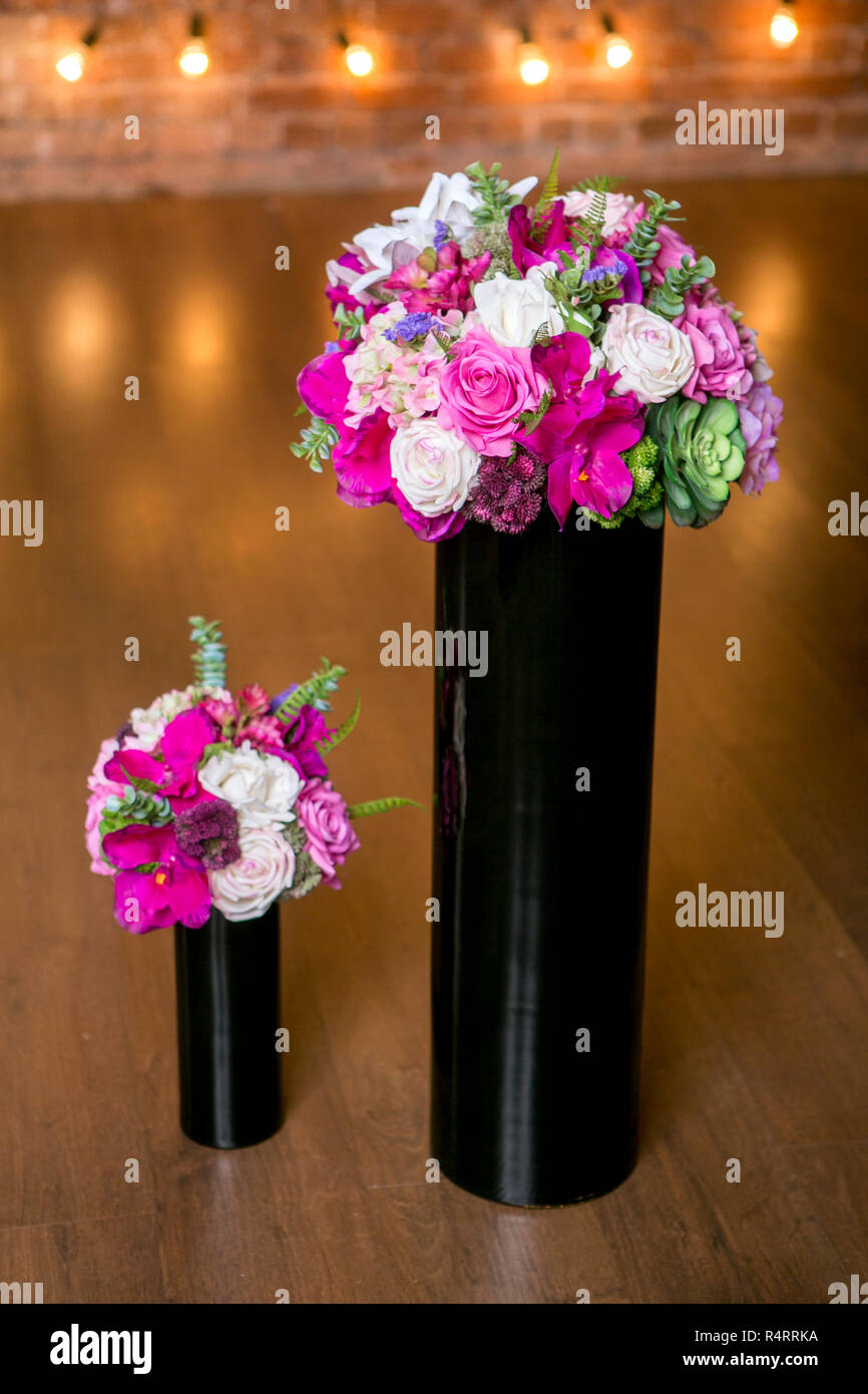 Two Bouquets Of Beautiful Mixed Flowers In Black Vases Lovely Bunch Of Flowers Work Of The Professional Florist Wedding Or Home Decor Stock Photo Alamy