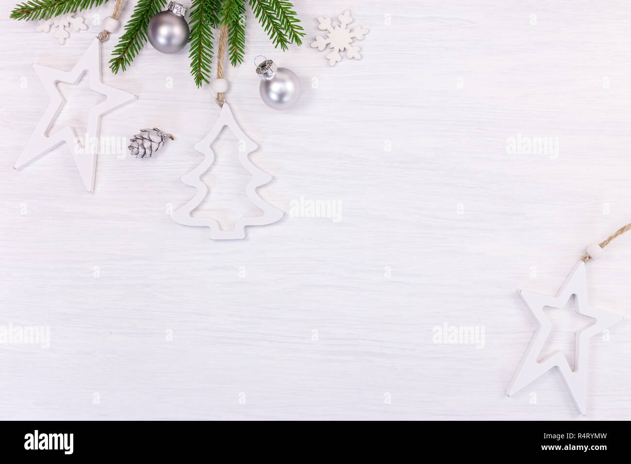 f7f1dfec9cd8 christmas holidays background with green fir tree branch, decorative silver  balls and white wooden stars. top view
