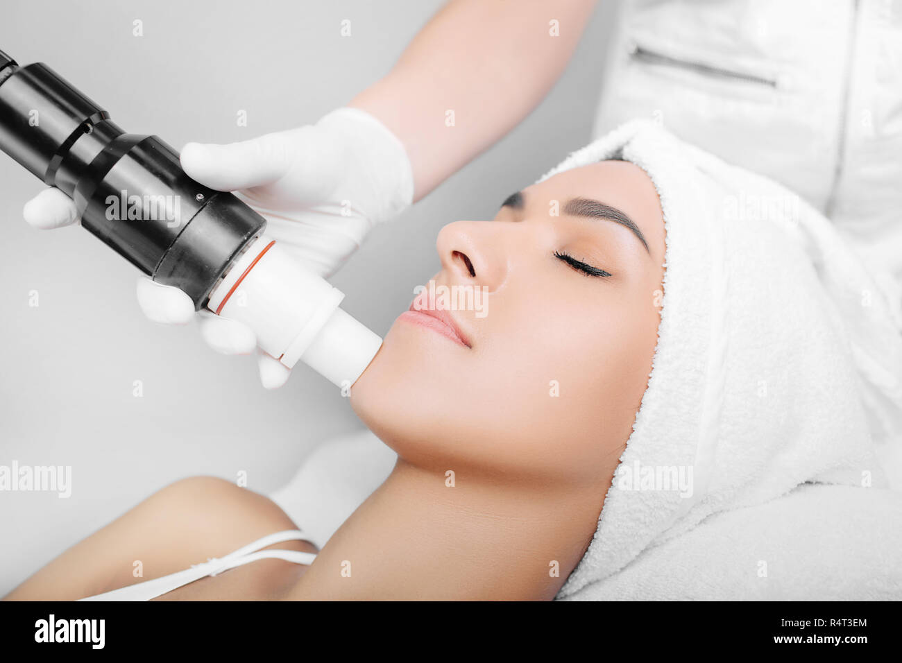 procedure wrinkle treatment , acoustic wave therapy on face - Stock Image
