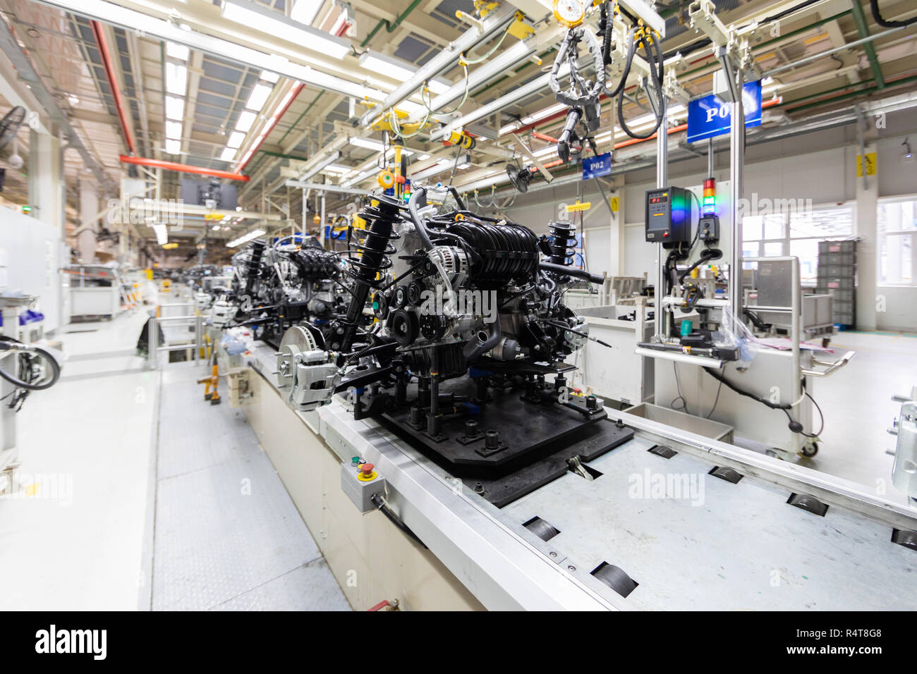 Assembly of motor vehicle. Robotic equipment makes Assembly of car. Modern car Assembly at factory - Stock Image