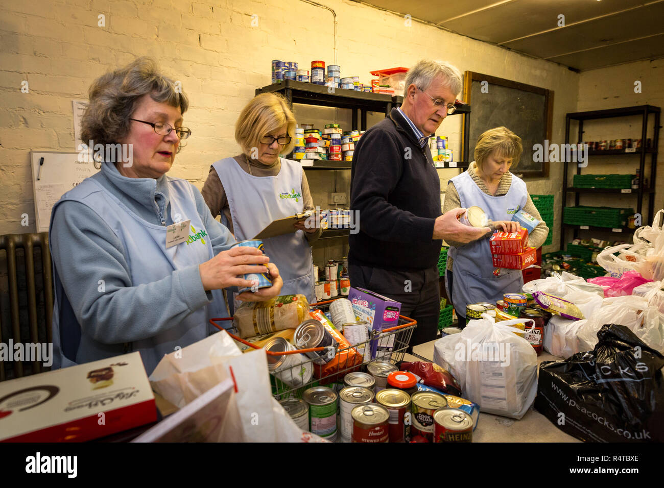 Volunteers sort out newly arrived donations at Arnold Foodbank Daybrook Baptist Church's food store and provide those in need with donated food in Nottingham. Stock Photo