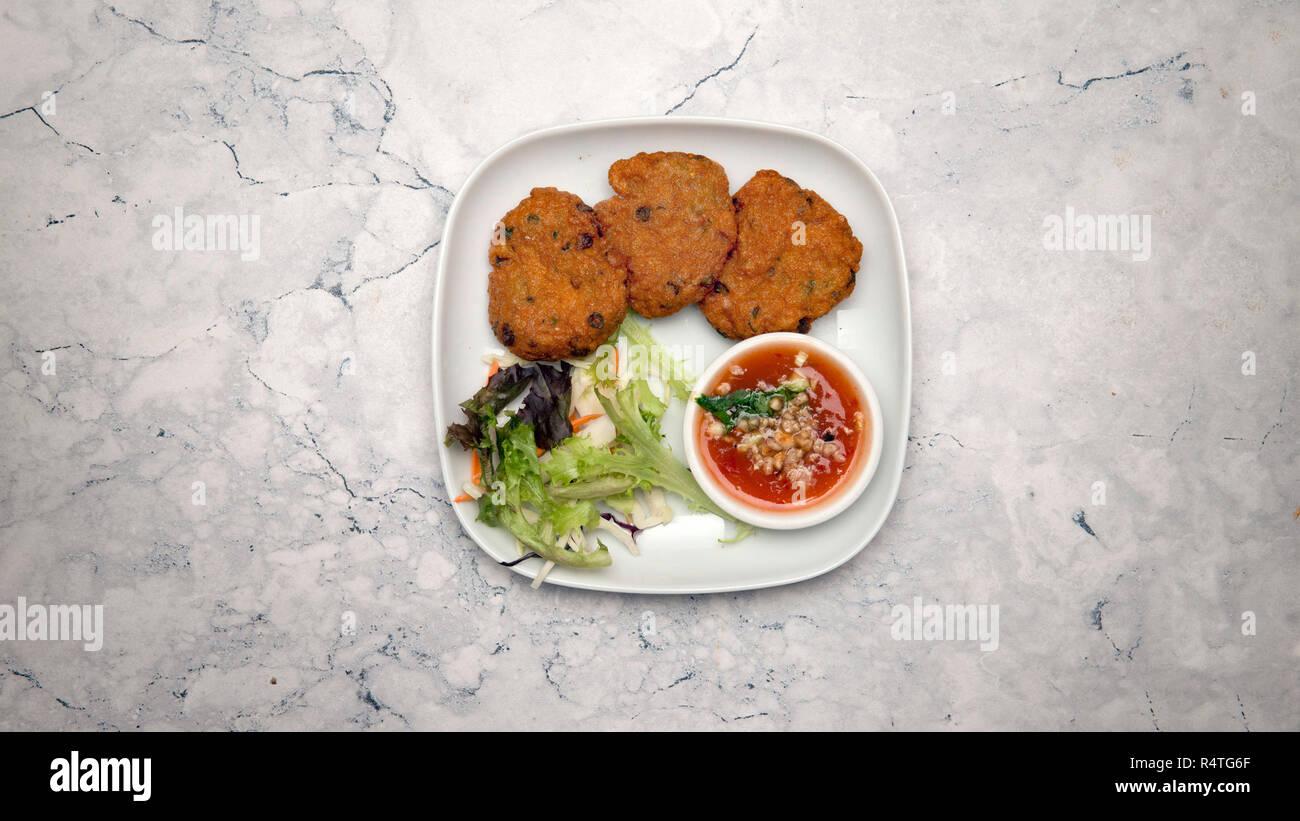 Oriental food, tod mun pla - Stock Image