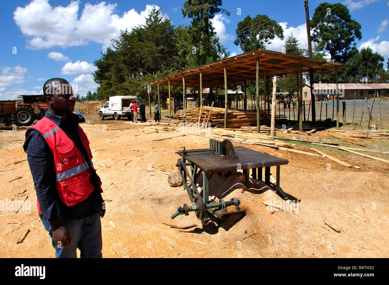 One of 10 Kenya Red Cross timber sites for reconstruction Kenyan farmhouses. Stock Photo