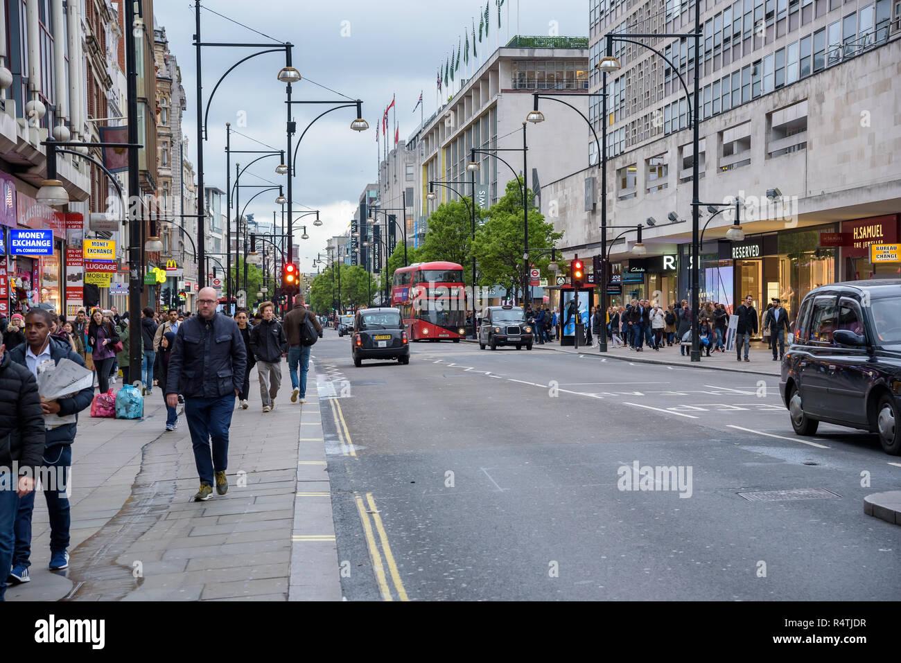 London, UK - Appril 26, 2018: People walk Oxford Street, main shopping destination in London Stock Photo