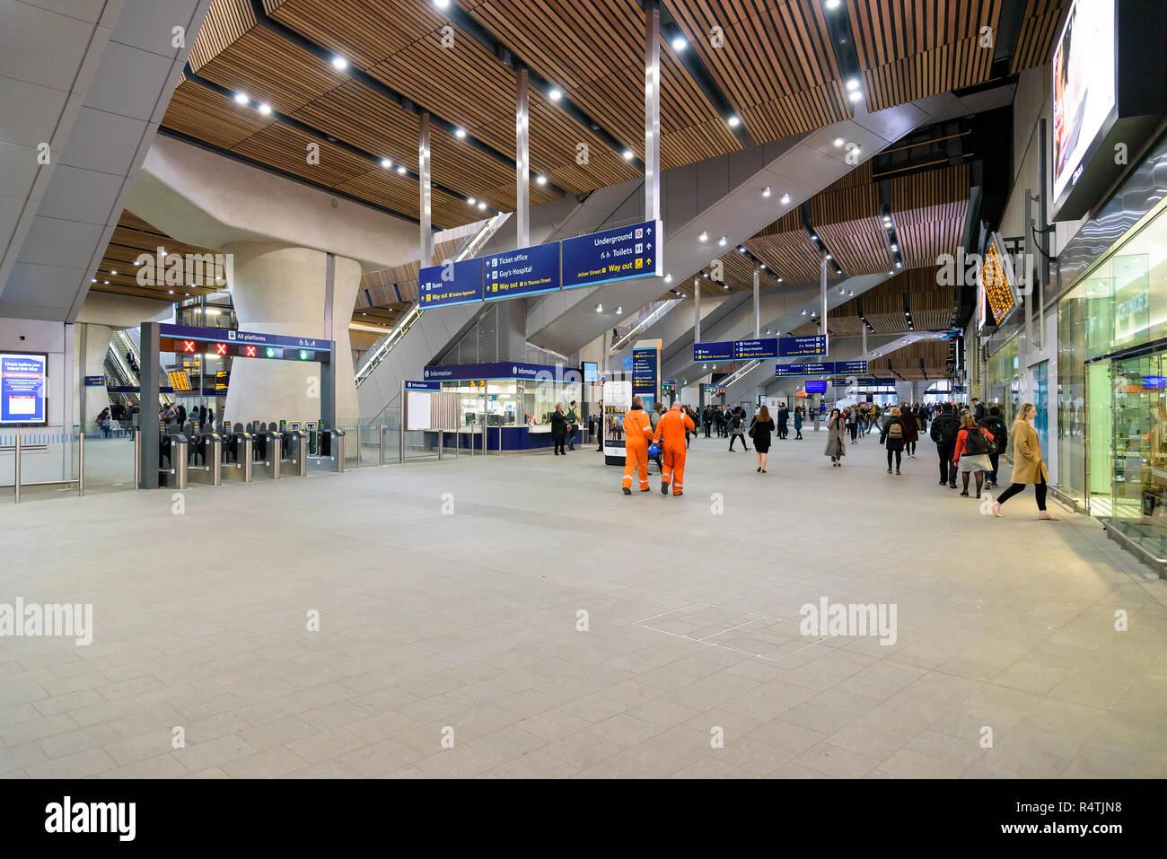 London, UK - April 26, 2018: Passengers at the London Bridge train station hall Stock Photo
