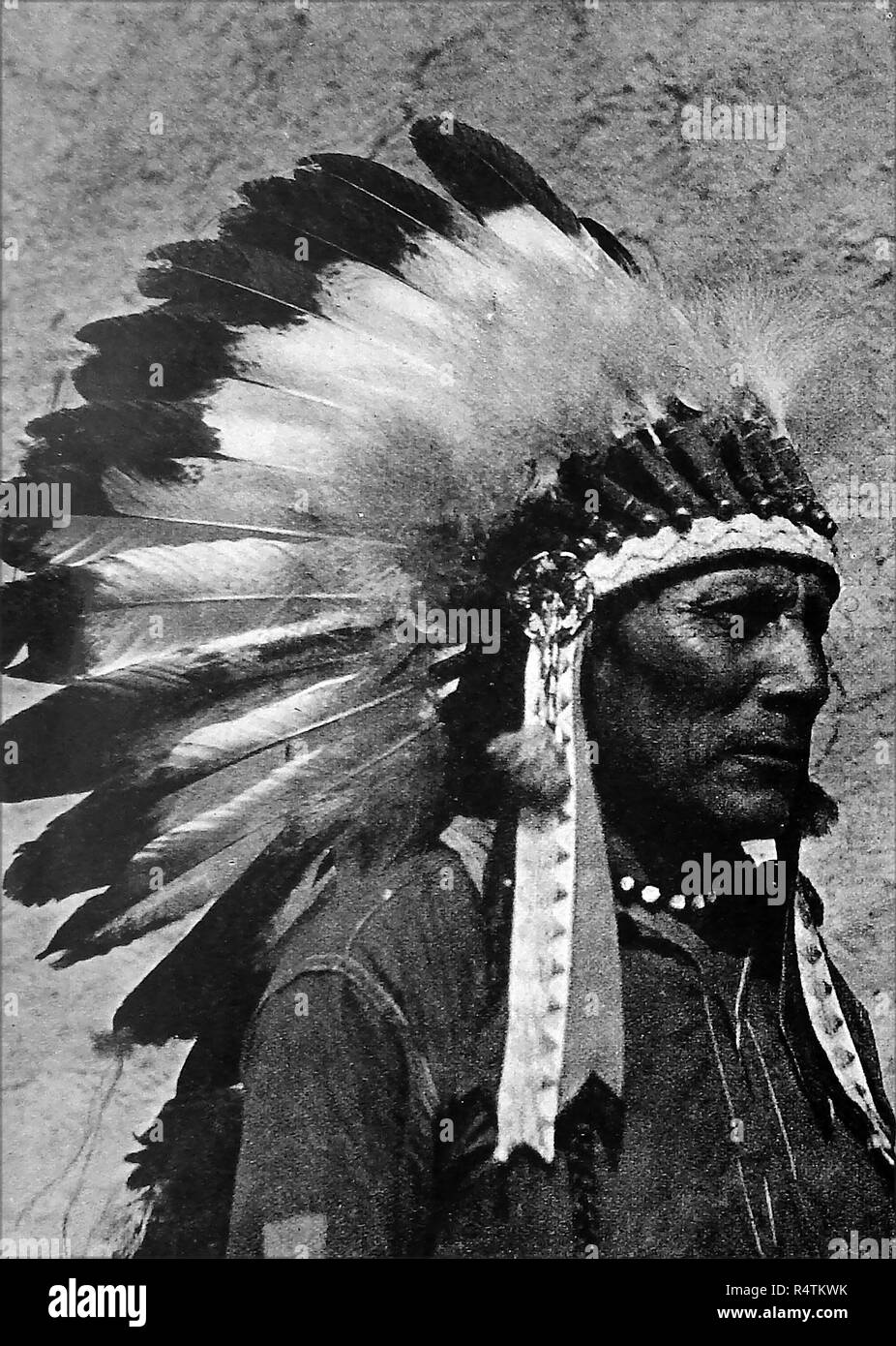 A 1946 image of a genuine native american Indian chief in full  feather headdress - Stock Image