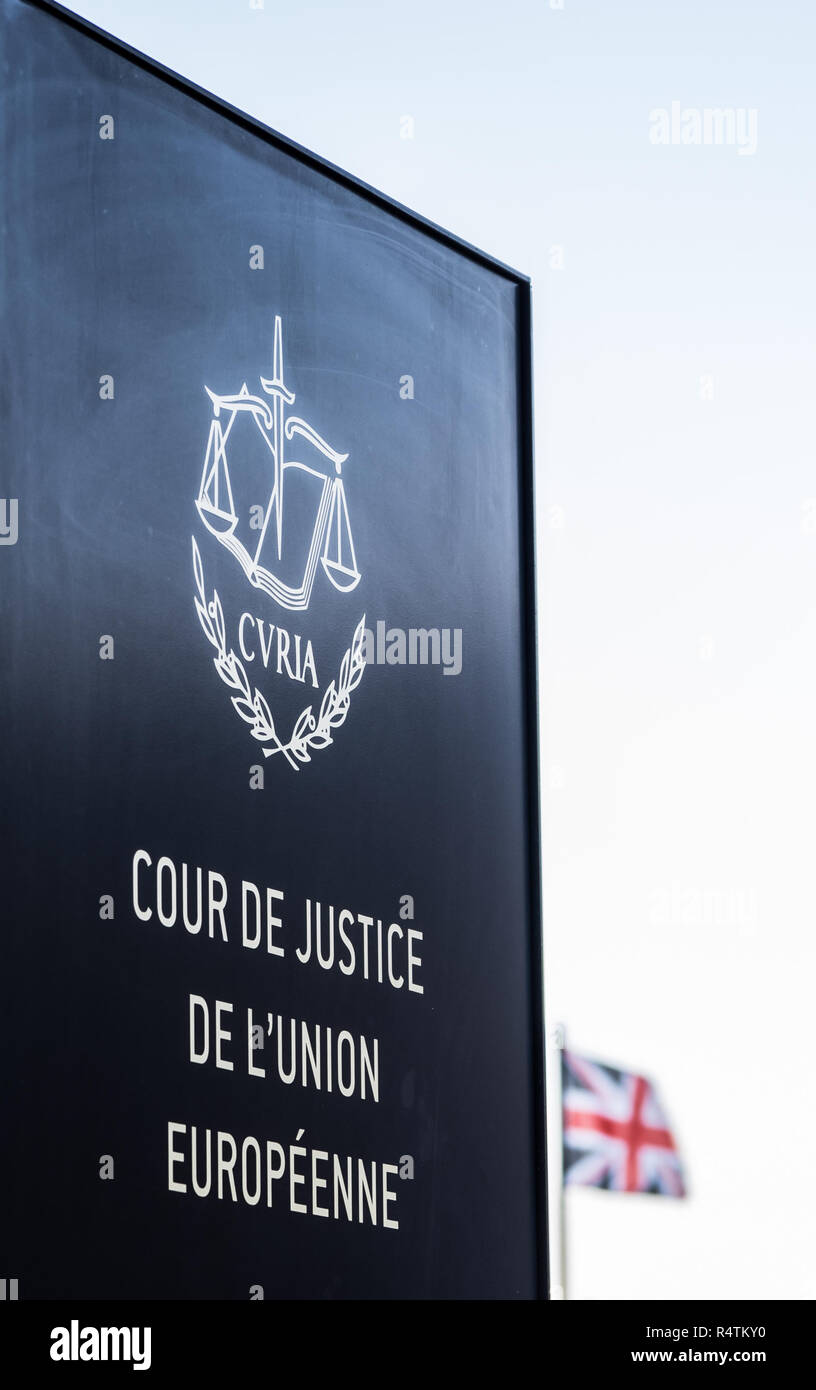In Luxembourg, the European Court of Justice sign, with an out-of-focus Union Jack in the background - Stock Image