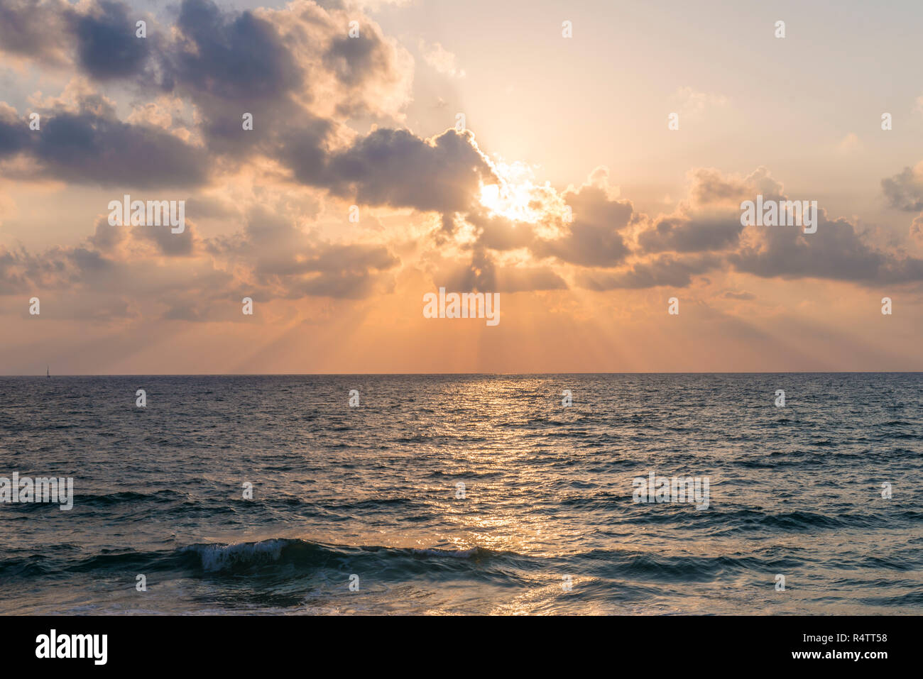 Sunset over the sea, clouds with sunrays, Tel Aviv, Israel - Stock Image
