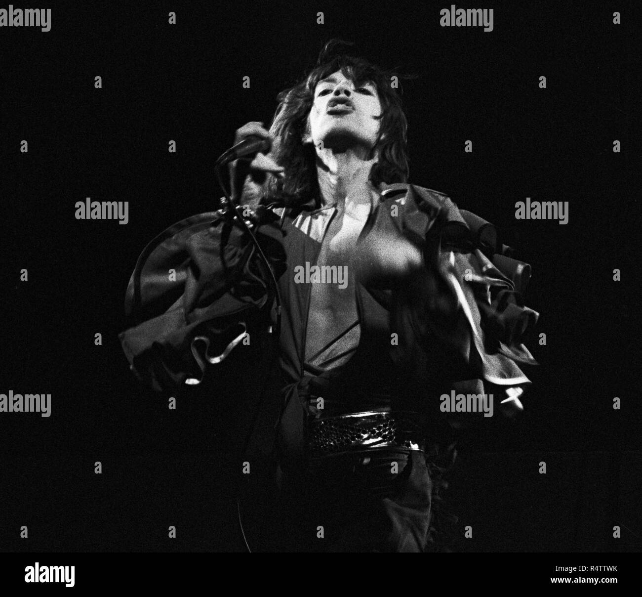 FRANKFURT, GERMANY: Mick Jagger from The Rolling Stones perform live on stage at the Festhalle in Frankfurt, Germany on April 28 1976 as part of their European tour (Photo by Gijsbert Hanekroot) *** Local Caption *** Rolling Stones, Mick Jagger Stock Photo