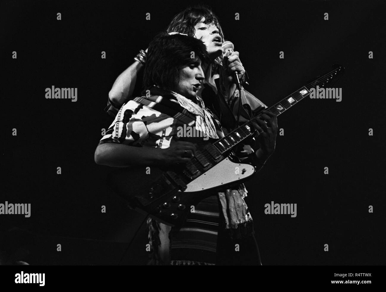 FRANKFURT, GERMANY: Mick Jagger, Ron Wood from The Rolling Stones perform live on stage at the Festhalle in Frankfurt, Germany on April 28 1976 as part of their European tour (Photo by Gijsbert Hanekroot) *** Local Caption *** Rolling Stones, Mick Jagger, Ron Wood Stock Photo