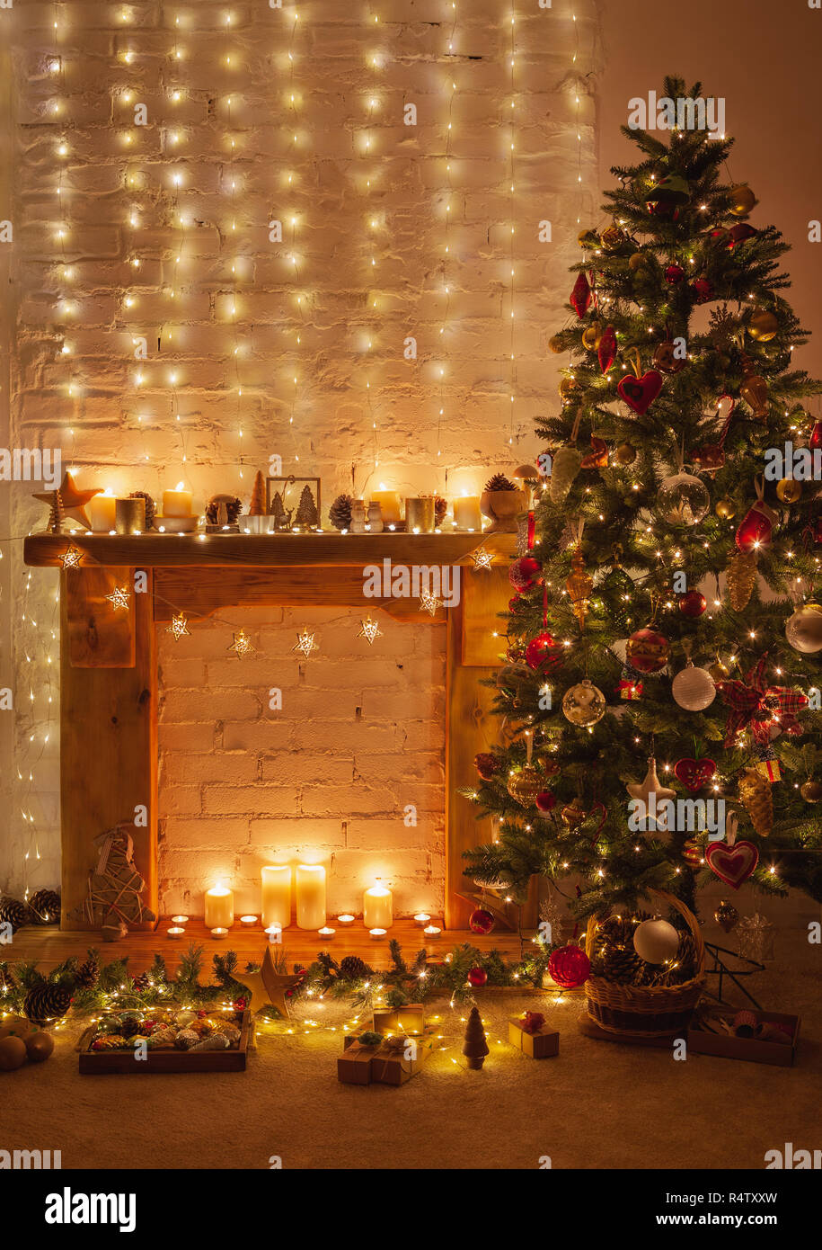 Beautiful Warm Christmas Setting Decorated Fireplace With Wood Mantelpiece Lit Up Christmas Tree With Red Gold Green Baubles And Ornaments Stars Li Stock Photo Alamy