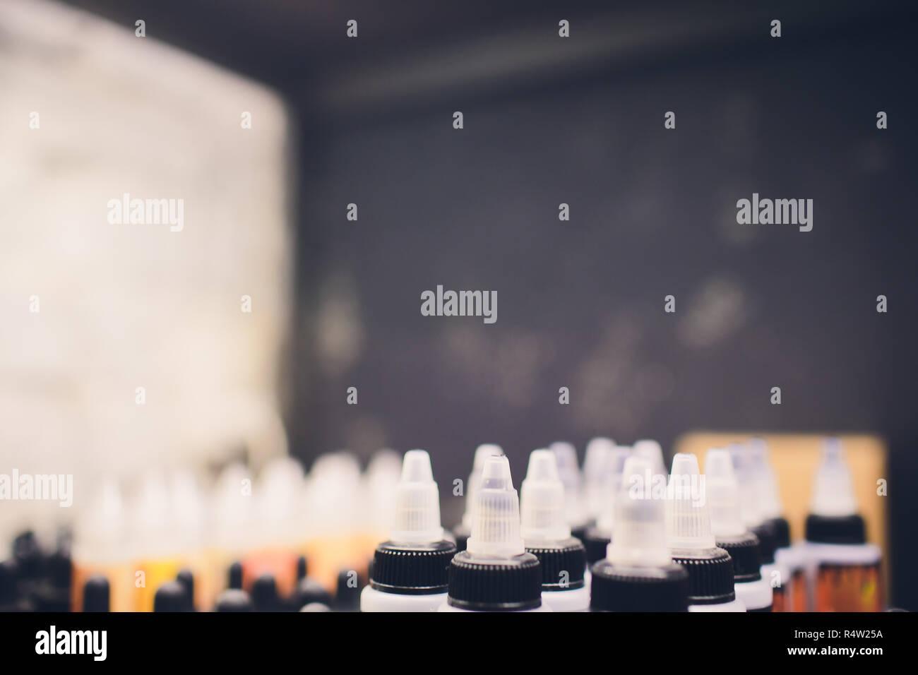 Flavor for electronic cigarette bottle liquid vape. Stock Photo