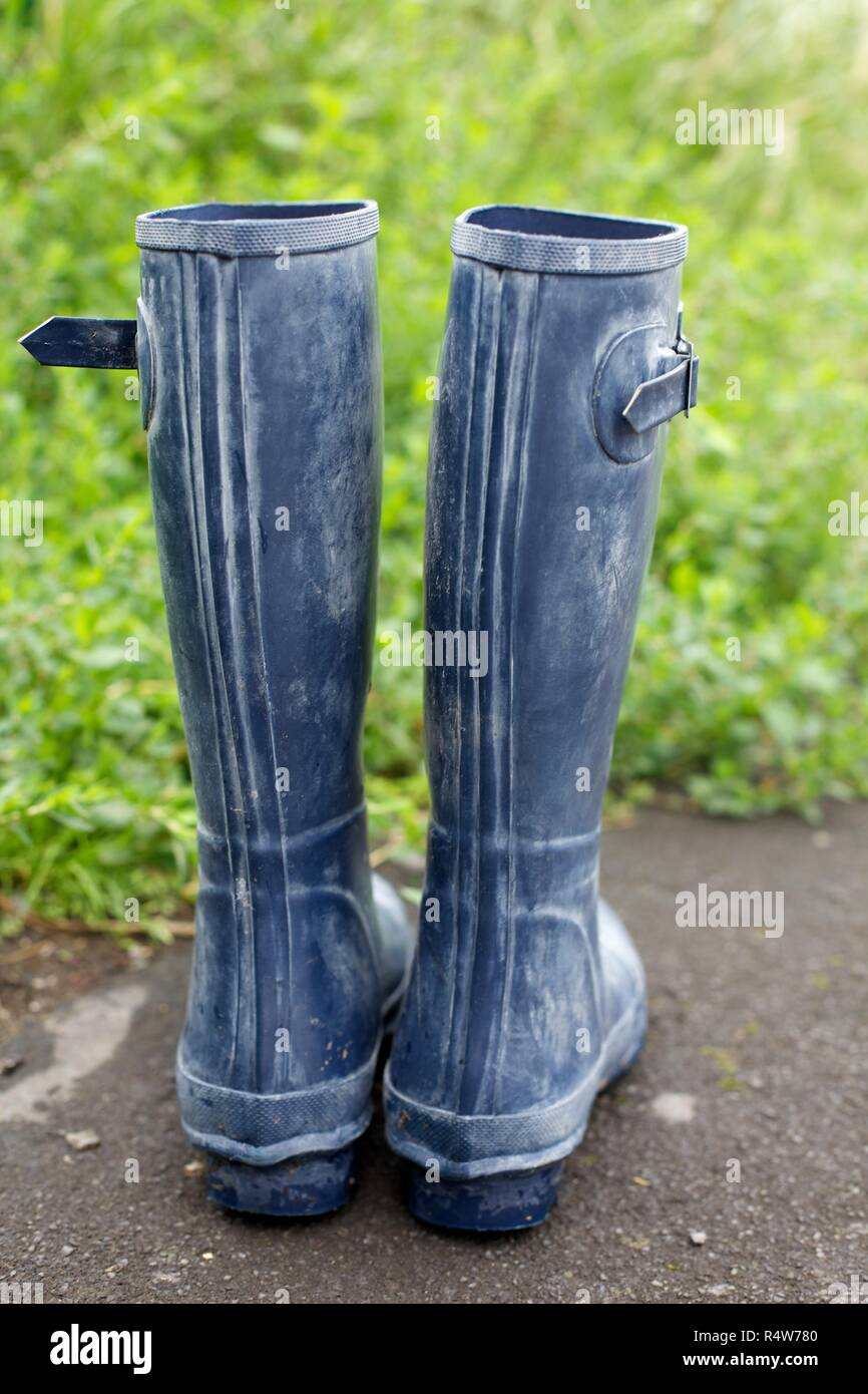 Rubber Wellington boots in the garden - Stock Image