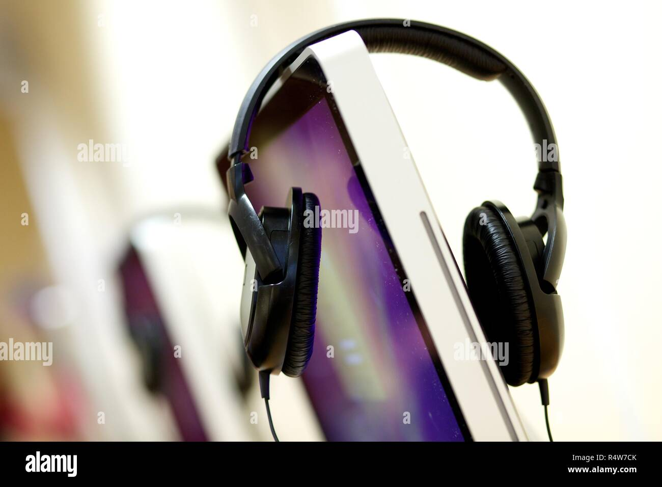 Headphones and desktop computer Stock Photo