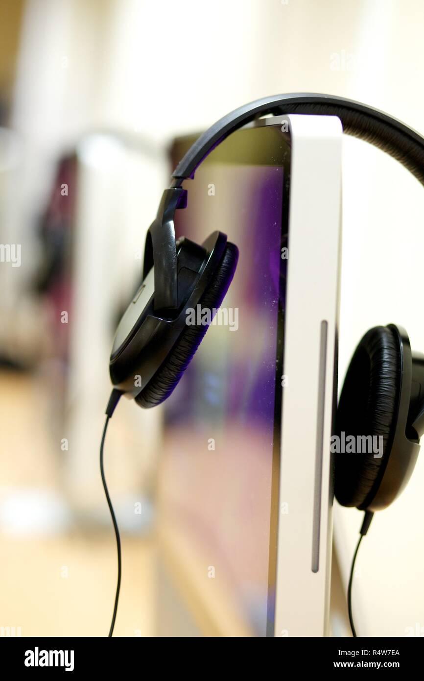 Headphones and desktop computer Stock Photo