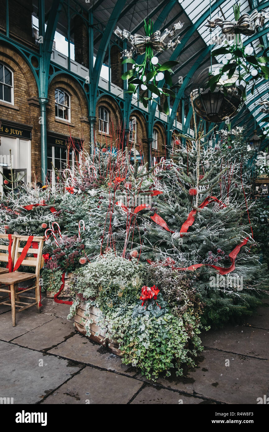 London, UK - November 21, 2018: Christmas trees and decorations in Covent Garden Market, one of the most popular tourist sites in London, UK. Stock Photo