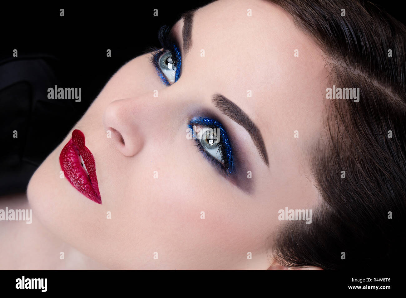 Close up of a young woman with open eyes - Stock Image